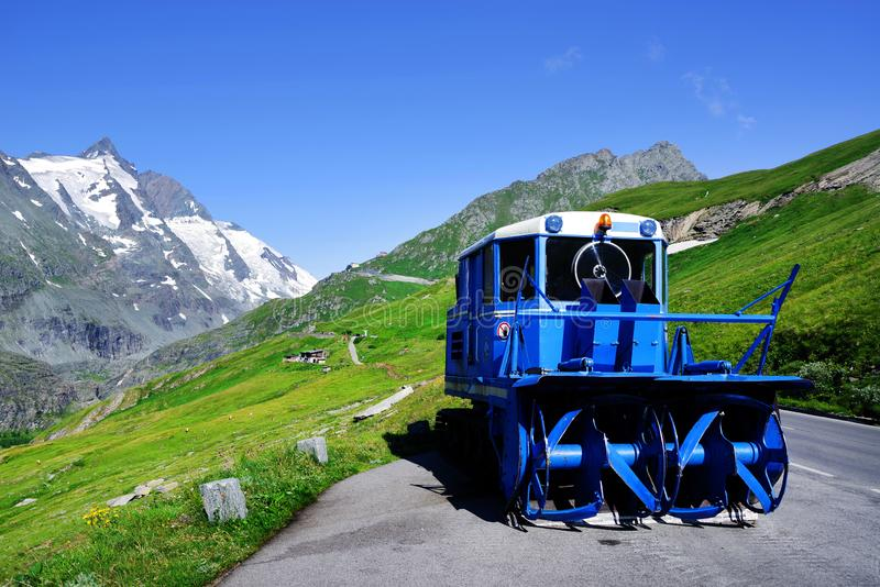 Blue snowplow in a parking on the Grossglockner High Alpine Road in summer time.. royalty free stock images