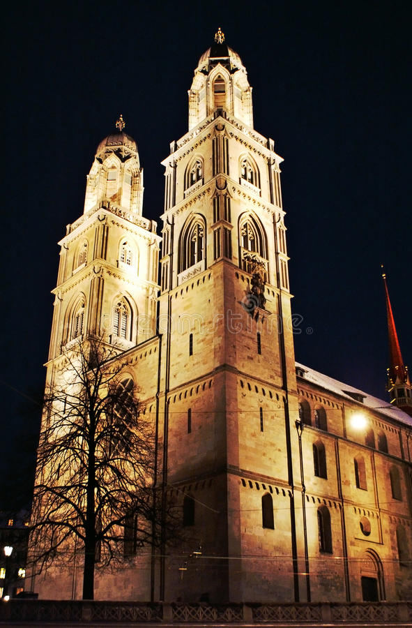 Grossmunster in Zurich at night in HDR royalty free stock photos