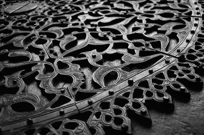 Groszak rzeźbiący drzwi obrazy royalty free