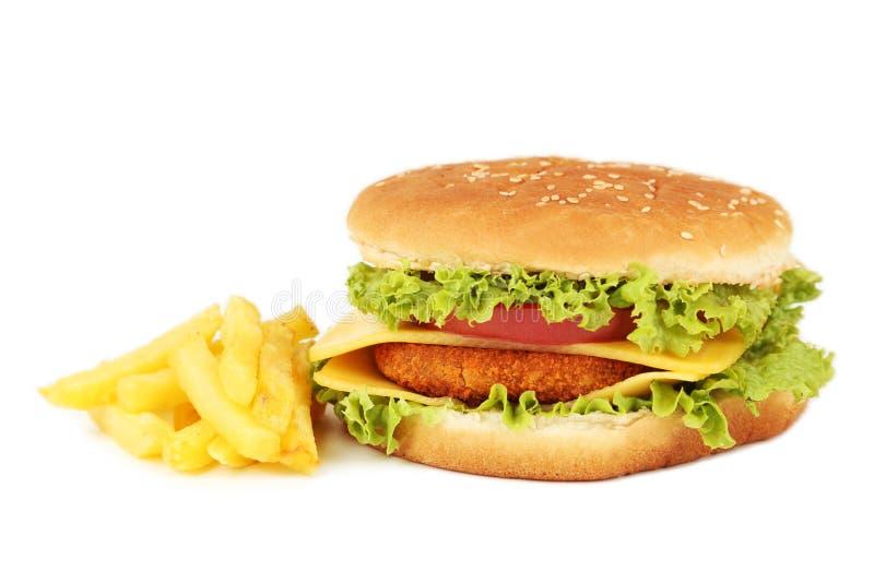 Grote die hamburger op wit wordt geïsoleerd stock afbeelding