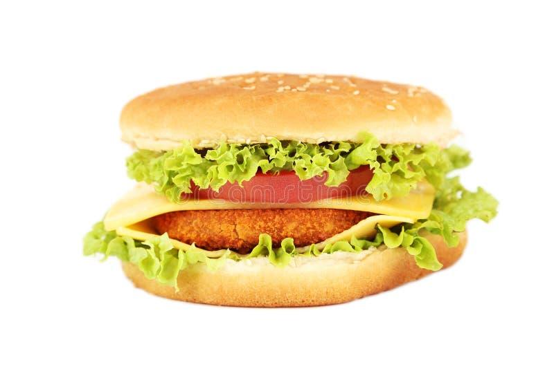 Grote die hamburger op wit wordt geïsoleerd royalty-vrije stock afbeeldingen