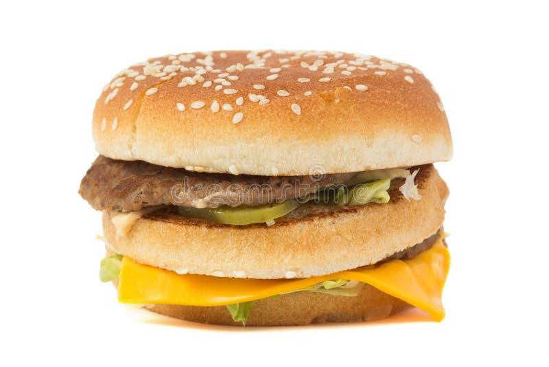 Grote die hamburger op wit wordt geïsoleerd royalty-vrije stock afbeelding