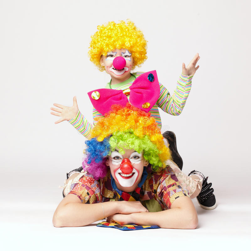 Grote en kleine grappige clowns royalty-vrije stock foto's