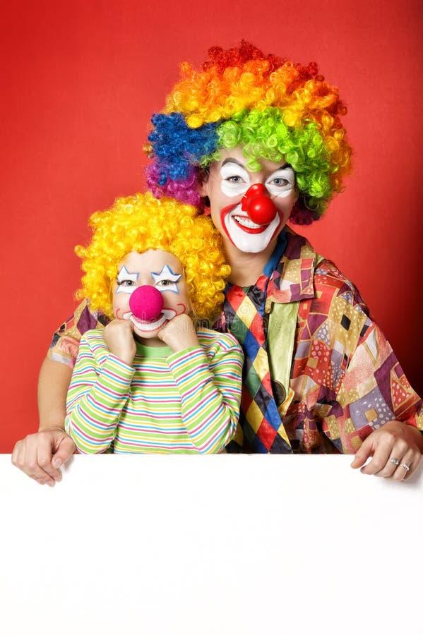 Grote en kleine grappige clowns royalty-vrije stock afbeelding