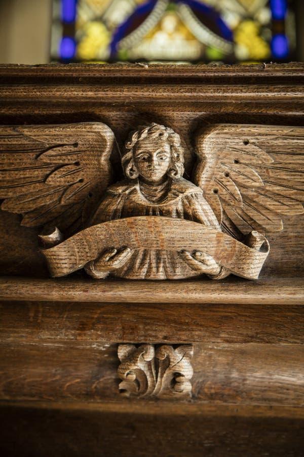Grote Givendale, Yorkshire dat, het UK, 25 Maart 2019, houten engel de Kerk van Heilige snijdt Ethelburgas stock fotografie