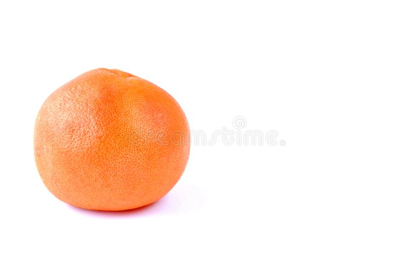 grote grapefruit op de lijst aangaande witte achtergrond royalty-vrije stock afbeeldingen