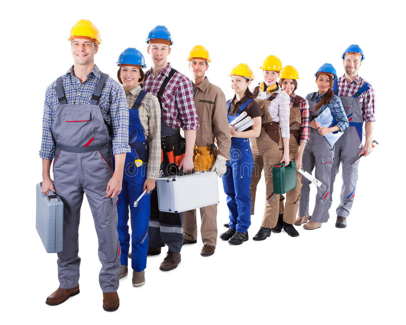 Grote groep bouwvakkers die omhoog een rij vormen stock afbeelding