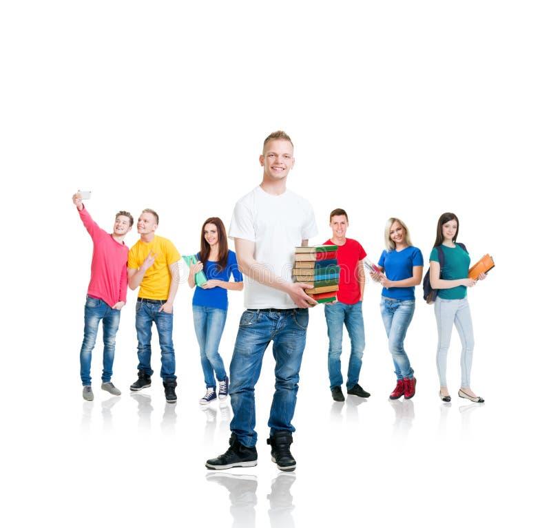 Grote groep tienerstudenten op wit stock afbeeldingen