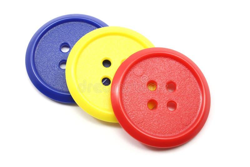 Grote rode, gele, en blauwe knopen royalty-vrije stock afbeelding