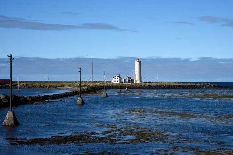 Grotta Island Lighthouse. Keywords:and blue cloud cold dock europe grotta harbor hills iceland island lighthouse near pear raid reykjavik sea sky tower stock images
