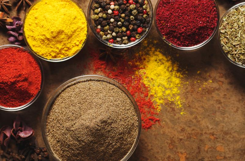 Ground Black Pepper. Place for text. Different types of Spices in a bowl on a stone background. The view stock images