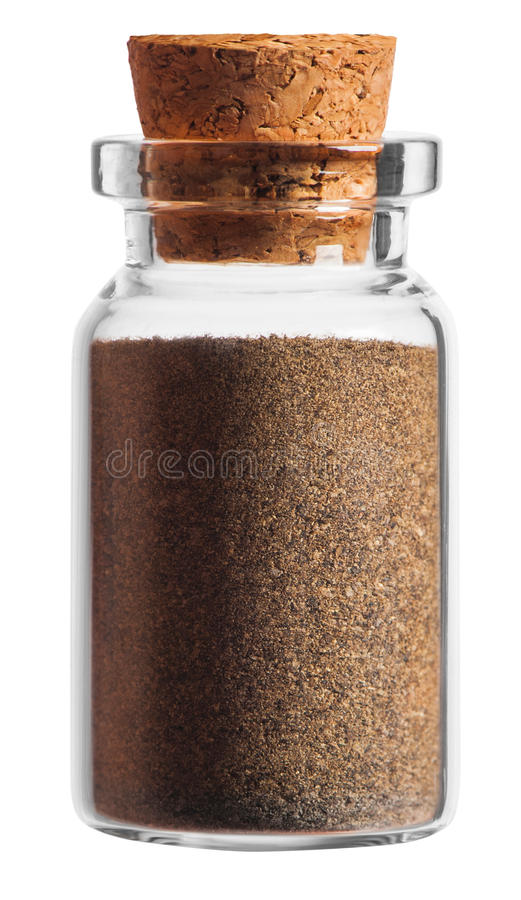 Ground black pepper spice in a little bottle isolated on white. Background royalty free stock photo