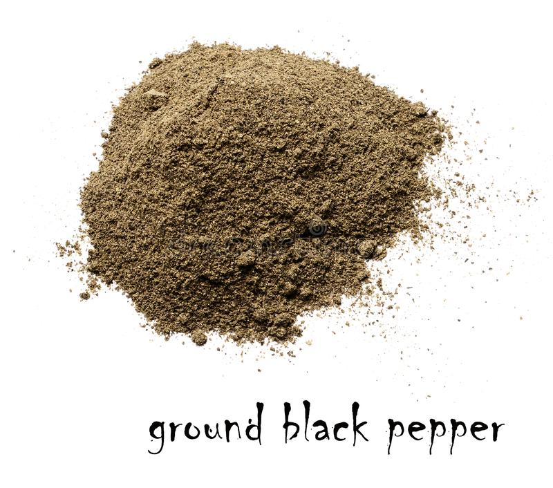 Ground black pepper. White isolated background.Top view. royalty free stock photos