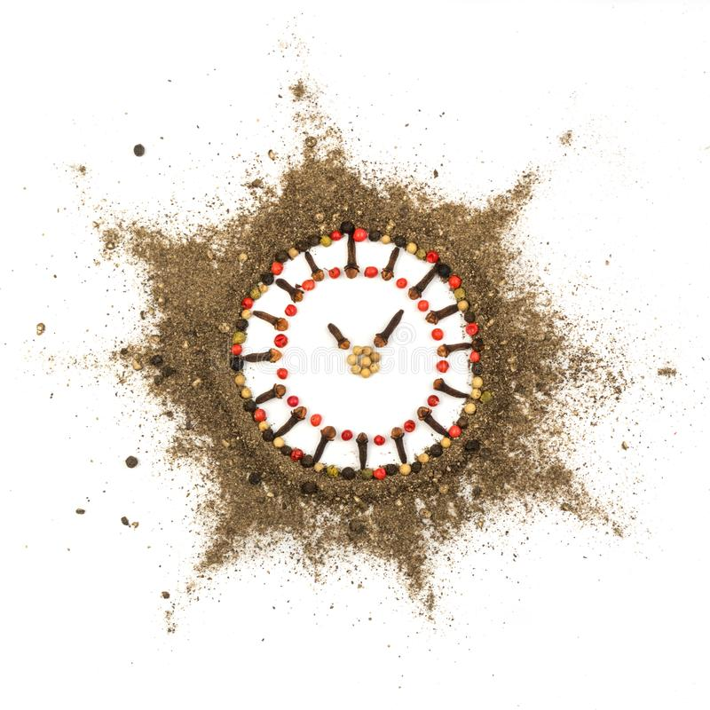 Ground Black Pepper Isolated. Ground Black and Red Pepper. Food Art. Spices Looks like Clock. Time for Spicy Food Concept royalty free stock image