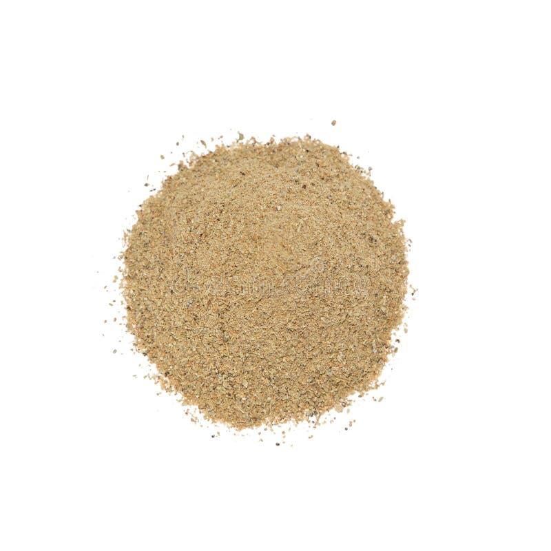 Ground cardamom. Isolated on white background royalty free stock photo