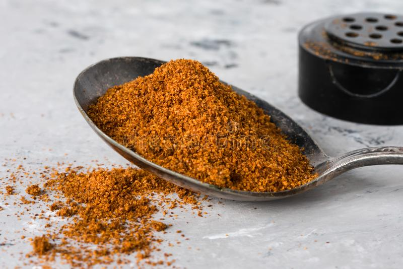 Ground Cayenne Pepper Spilled from a Vintage Spoon royalty free stock photo