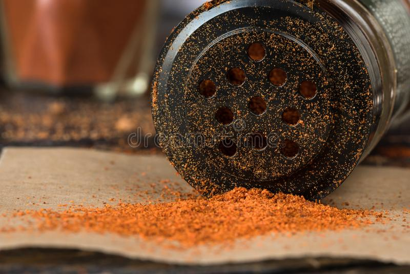 Cayenne Pepper Spilled from a Spice Shaker royalty free stock images