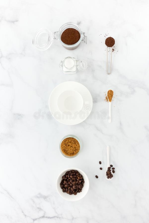 Ground Coffee and Beans, White and Brown Sugar and Coffee Cup royalty free stock image
