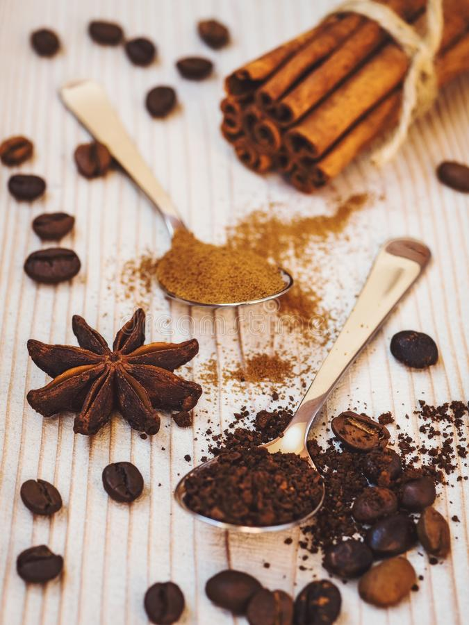Ground coffee and cinnamon in spoons royalty free stock photo