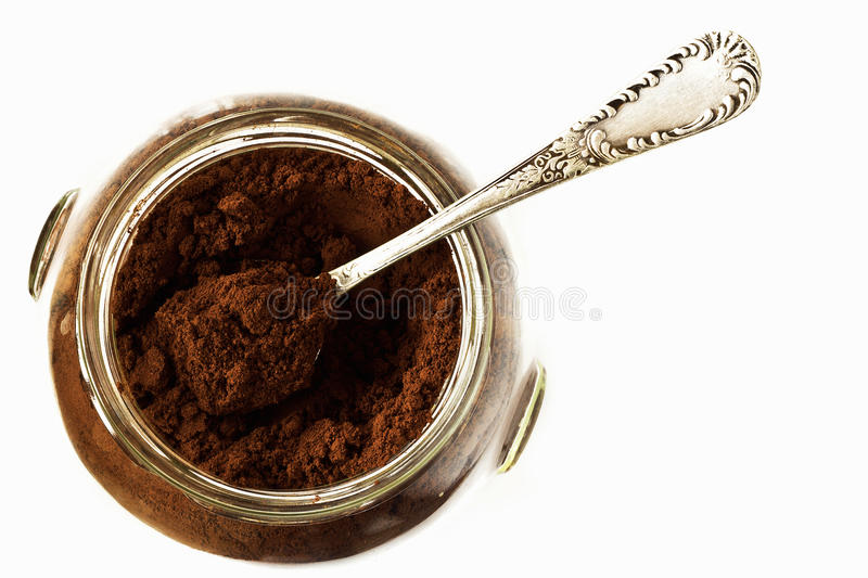 Ground coffee in a glass jar royalty free stock photos