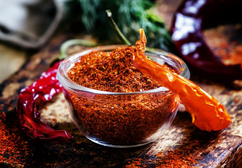 Ground dried red cayenne pepper, rustic style, selective focus o. N the contents of the bowl royalty free stock image