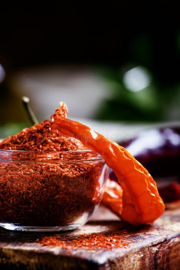 Ground dried red cayenne pepper, rustic style, selective focus o. N the contents of the bowl royalty free stock photo