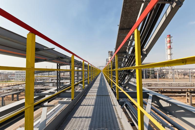 Ground maintenance, cable and pipeline project. At a petrochemical plant stock photos