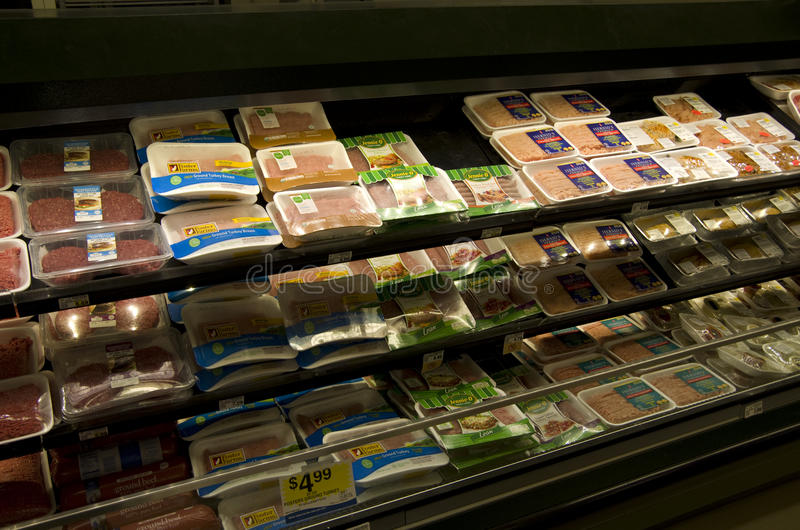 Ground meats in grocery store stock photo