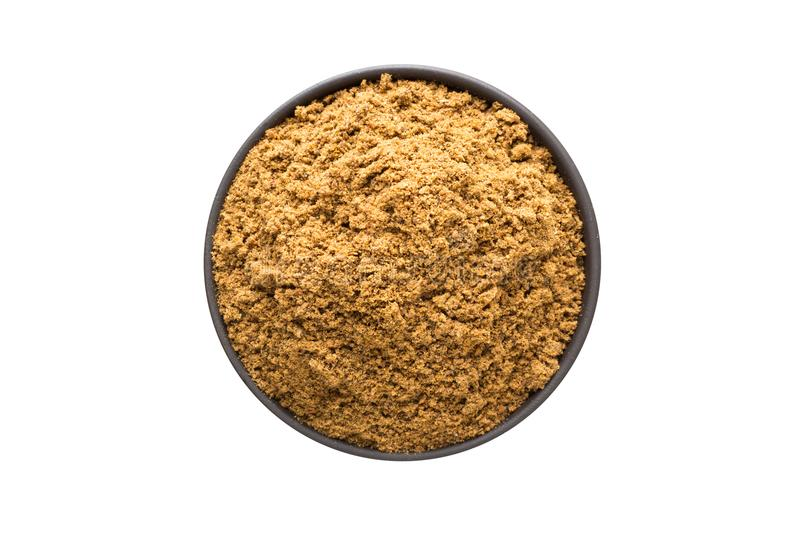 Ground nutmeg powder in clay bowl isolated on white background. Ground nutmeg powder in bowl, top view, isolated on a white background. organic spice stock images