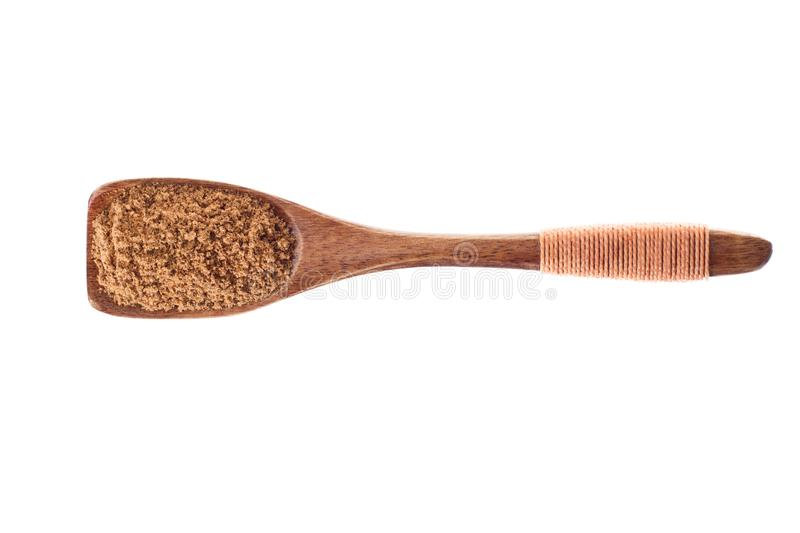 Spice ground nutmeg powder in wooden spoon isolated on a white royalty free stock image