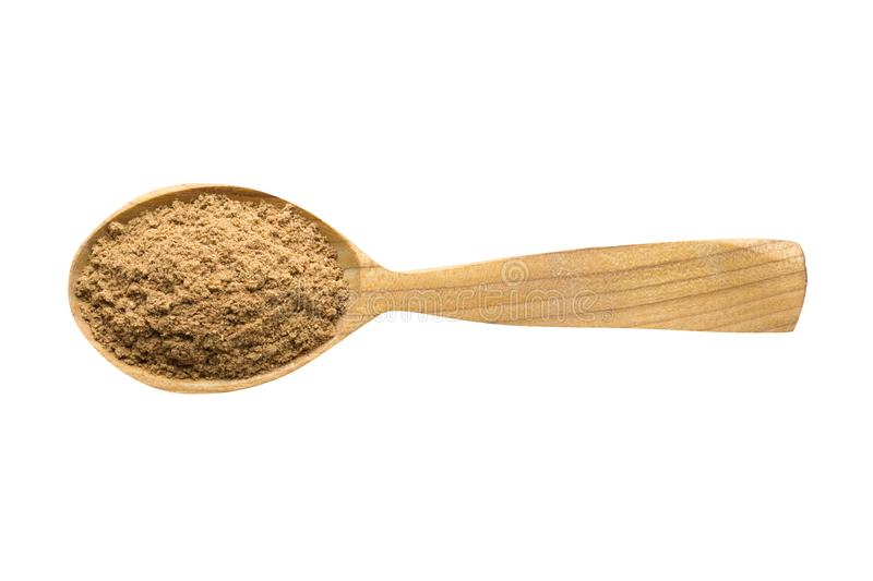 Ground nutmeg powder in wooden spoon isolated on white background. spice for cooking food, top view. Ground nutmeg powder for adding to food. spice in wooden stock photos