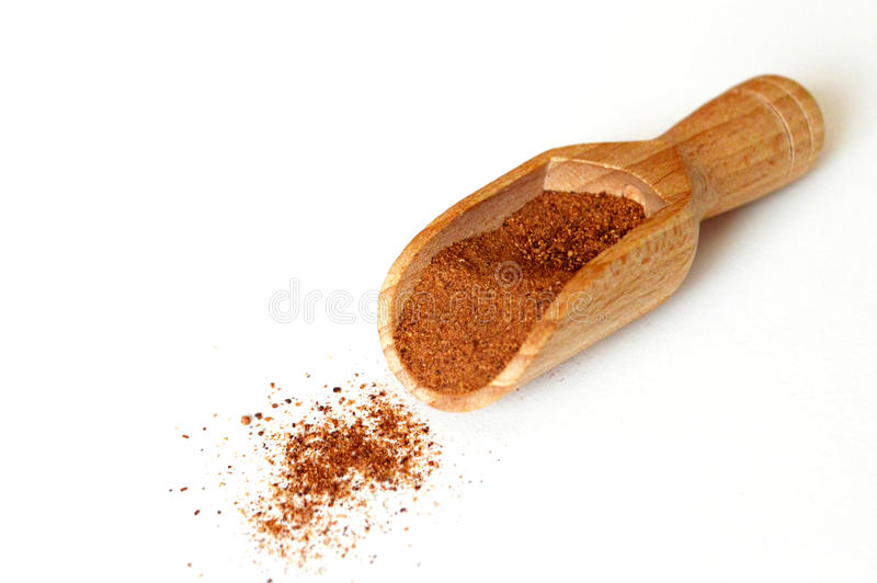 Ground nutmeg in wooden scoop stock images
