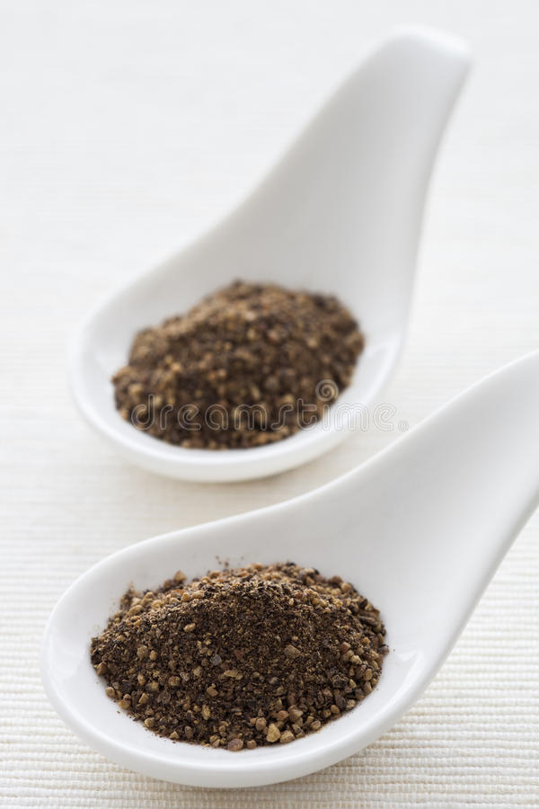 Ground pepper. Ground black pepper with natural light stock image