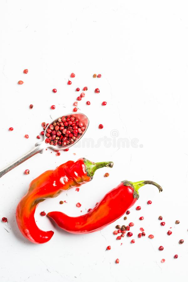 Ground pepper, peppercorn and fresh chili pepper on white. Background. Top view stock images