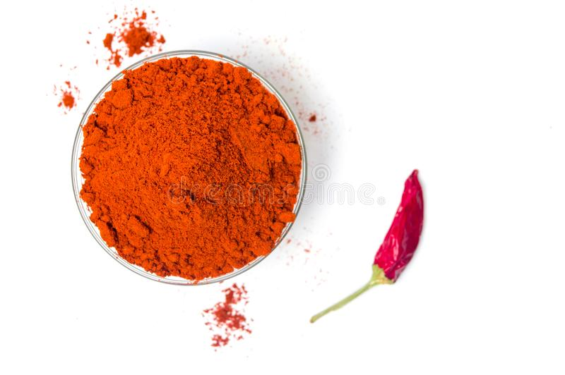Ground red pepper in a bowl isolated. Ground red pepper in a glass bowl isolated stock photos