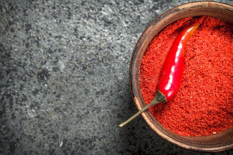 Ground red pepper in a bowl. royalty free stock images