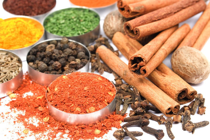 Ground red pepper and other indian spices royalty free stock photo