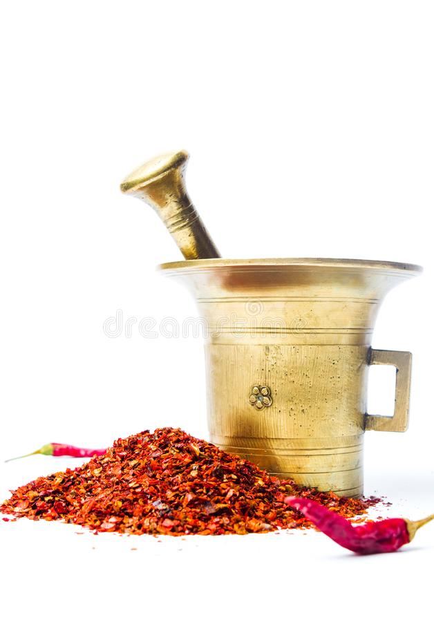 Ground red pepper and a vintage mortar royalty free stock images