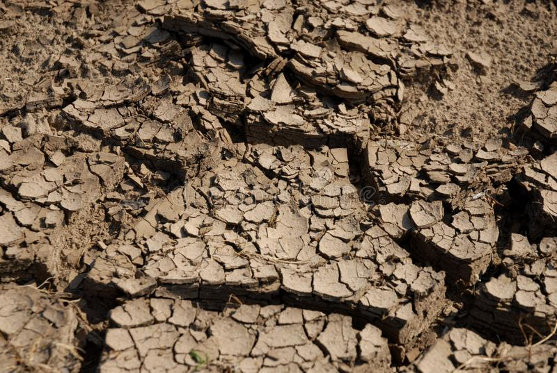 Cracks in the ground in the dry hot season stock photography