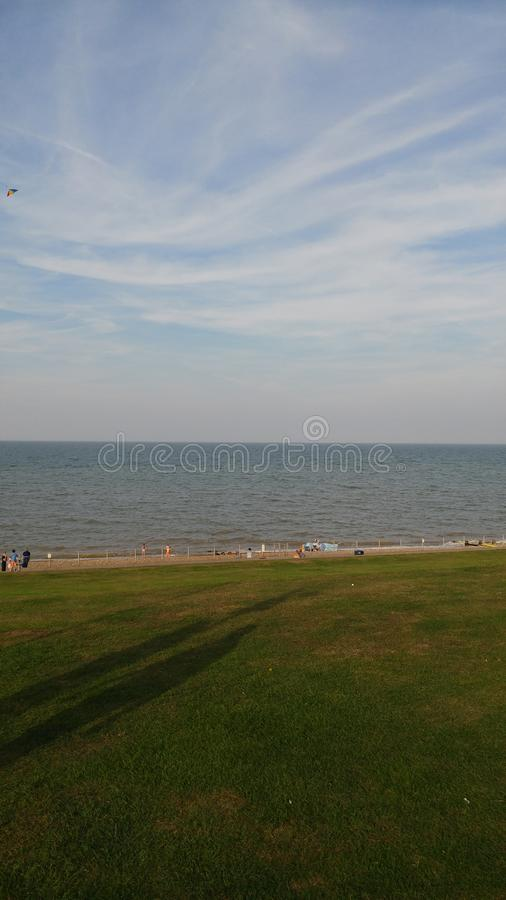 Ground shot of beach and sky. Showing the sea at full tide stock photos