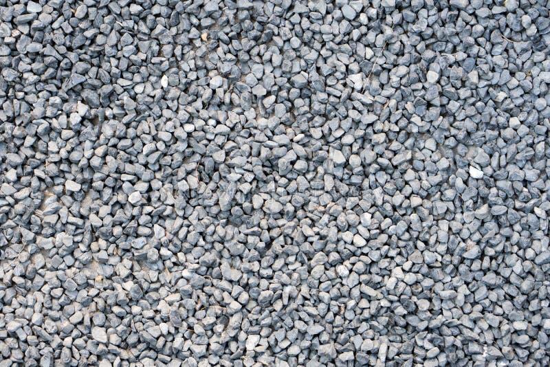 Ground stone, grey, background of many small stones. royalty free stock photos