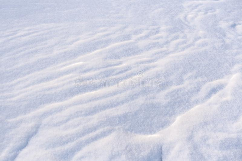 Ground surface covered with fluffy freshly fallen white snow. Winter snowy background stock image