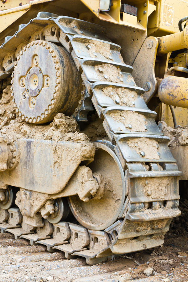 Ground on track. Big roller and ground on track bulldozer royalty free stock image