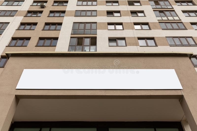 Ground view of straight luxury apartment facade with copyspace.  stock photos