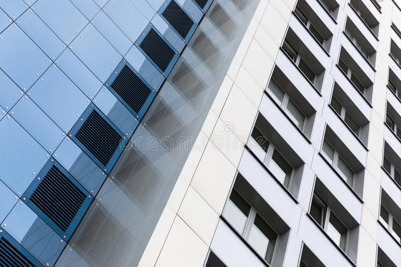 Ground view of tall modern building facade, blue and white smooth facade surface. Ground view of tall modern building facade, blue and white smooth facade stock photography