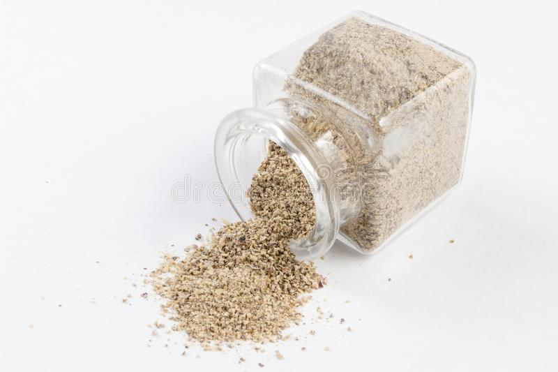 Ground white pepper in a glass jar isolated on white background.  stock image