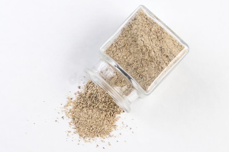 Ground white pepper in a glass jar isolated on white background. top view.  stock photo