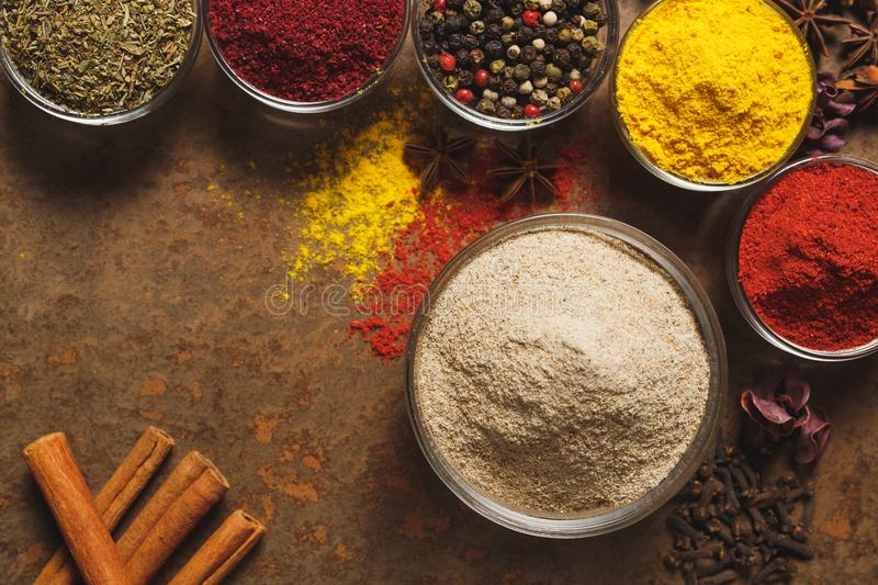 Ground White Pepper. Place for text. Different types of Spices in a bowl on a stone background. The view from the top stock image