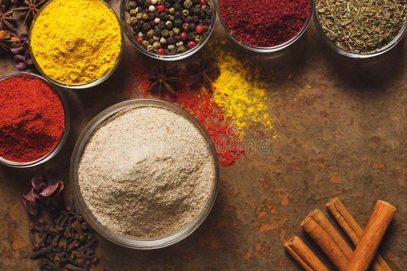 Ground White Pepper. Place for text. Different types of Spices in a bowl on a stone background. The view from the top.  royalty free stock image