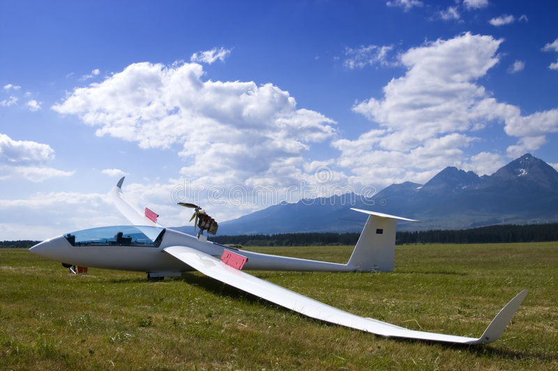 Grounded glider. View of a modern white glider royalty free stock photography